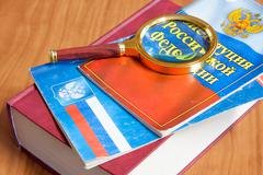 Codes of laws of the Russian Federation and magnifier - stock photo