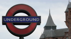 Underground logo near the Cruciform Building in London Stock Footage