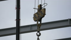 Close up view of a tower crane hook in London Stock Footage