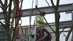 Men with helmets working at a construction in London Stock Footage