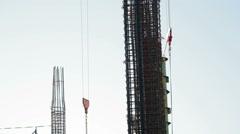 Stock Video Footage of Cranes move supplies at skyscraper construction site, Tel-Aviv, Israel