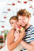 Young couple eating ice cream outdoor Stock Photos