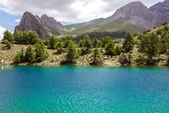 Blue lake and forest terrain in Asia - stock photo