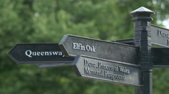 Direction signs for Elfin Oak and Diana Memorial Playground in London Stock Footage