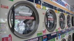 Coin operated public washing machines in a dry cleaner shop in Taipei, Taiwan Stock Footage