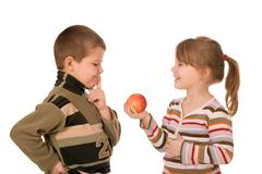 Two children and an apple - stock photo