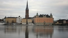 Houses and city hall tower reflecting in the ice, Stockholm Stock Footage