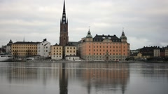 City hall of Stockholm reflecting in the ice Stock Footage