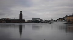 City hall reflecting in the ice on a cloudy day, Stockholm Stock Footage