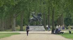 Tourists relaxing close to the Physical Energy Statue in London Stock Footage
