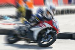 High speed movement of motorbike racing - stock photo