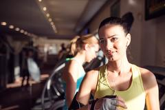 Detail, attractive woman in gym after running on treadmill Stock Photos