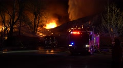 Firefighters Spraying Water On Structure After It Collapses Stock Footage