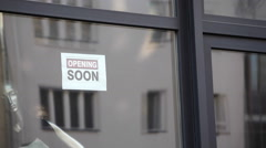 Coming soon sign in shop window Stock Footage