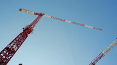 Huge red white construction site crane, skyscraper building, Tel-Aviv, Israel - stock footage