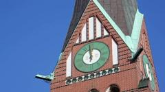 Church clocktower on a bright sunny day, blue sky, Berlin, Germany Stock Footage
