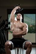 Young Bodybuilder Exercise Triceps In The Gym Stock Photos
