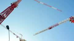 3 tall red white cranes move supplies, skyscraper construction site, Tel-Aviv - stock footage