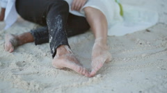 Love Couple Draw Feet Heart On Sand Stock Footage