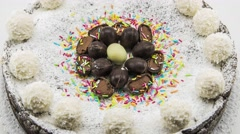 Ricotta and chocolate cake decorated with chocolate eggs. - stock footage