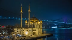 Ortakoy Mosque and the Bosphorus Bridge at night Istanbul Turkey Stock Footage