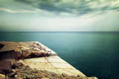 View over stormy sea and clouds - stock photo