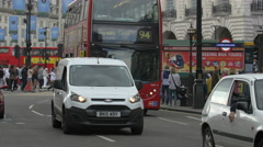 Driving red buses in Piccadilly Circus, London Stock Footage