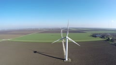 Aerial bird view low altitude of wind turbine providing renewable energy 4k Stock Footage