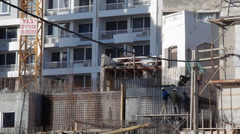 Construction workers build skyscraper in Tel-Aviv, Israel Stock Footage