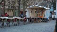 Empty wooden stalls at farmers market, preperations, Berlin, Germany Stock Footage