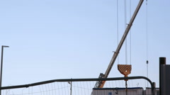 Crane hook goes down to move construction site supplies, Tel-Aviv, Israel - stock footage