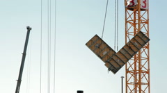 Large metal concrete mold frame moved by crane, construction site, Israel Stock Footage
