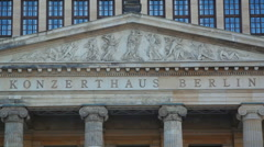 Outside Konzerthaus Berlin concert hall, tilt down to Schiller Monument Stock Footage