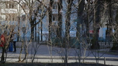 People walk in the park on a chilly day, Berlin, Germany - stock footage