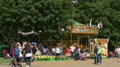 Carousel in an amusement park in London Stock Footage