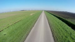 Aerial drone flying very low and fast over polder grassland straight road 4k Stock Footage