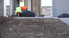 Stock Video Footage of LANDSCAPE CREW FOR NEW HOUSES, coiled drain pipe
