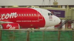AirAsia Airbus 320 taxiing Stock Footage