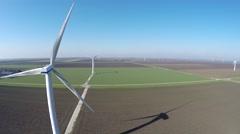 Aerial bird view moving back wind turbine windmill renewable energy 4k Stock Footage