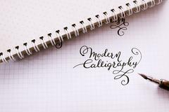 Stock Photo of Hand drawn lettering background. Lettering brush calligraphy on paper