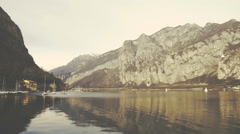 Como Lake with boats and mountains in the background - stock footage