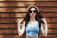 Beautiful girl poses for camera in the city Stock Photos