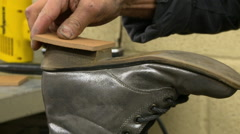 Shoe Repair Heel on ankle boot Stock Footage