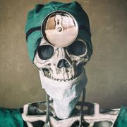 Skeleton Doctor Hear Mirror - stock photo