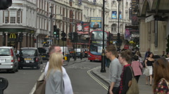 Driving cars and red bus on Shaftesbury Avenue in London Stock Footage