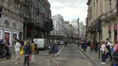 People walking on Shaftesbury Avenue in London Stock Footage
