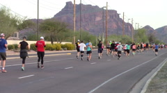 Rear view of runners participating in a marathon Stock Footage
