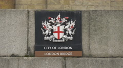 The London coat of arms on the London Bridge pier Stock Footage