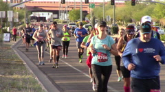 Front view of runners participating in a marathon Stock Footage