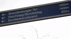 Street sign leading to tourist sights, Brandenburger gate, Reichstag, Berlin Stock Footage